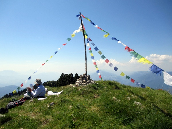 Photograph of the summit of Rocher de Chalves, Grande Sure, adorned with Budhist prayer flag