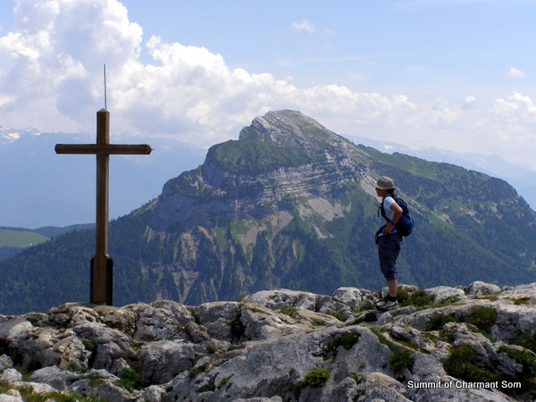 Photograph of the Charmant Som summit cross with Chamechaude behind