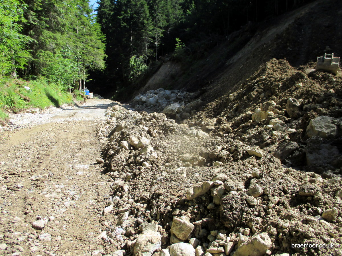 Photograph of the state of repairs to the Col du Coq road
